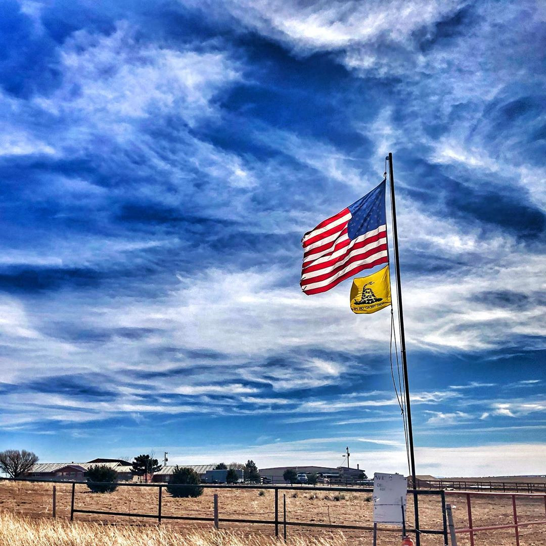 The Stars and Stripes flies above Cowboy's ranch in New Mexico