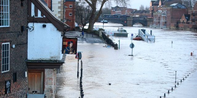 A view of a flooded street after the River Ouse burst its banks in the aftermath of Storm Ciara, in York, England, Monday, Feb. 10, 2020.