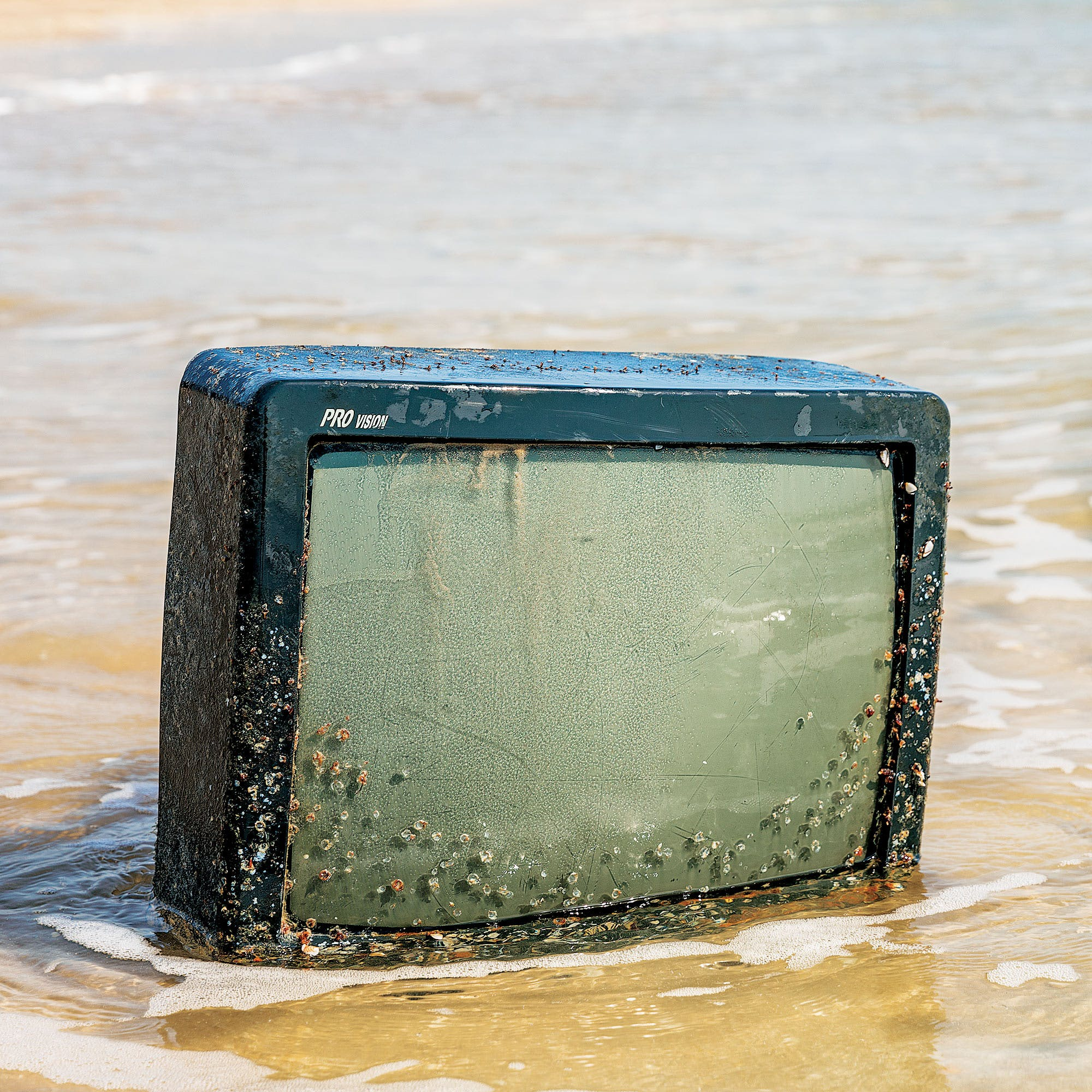 Barnacles cling to a television washed up on the beach around mile marker 27.