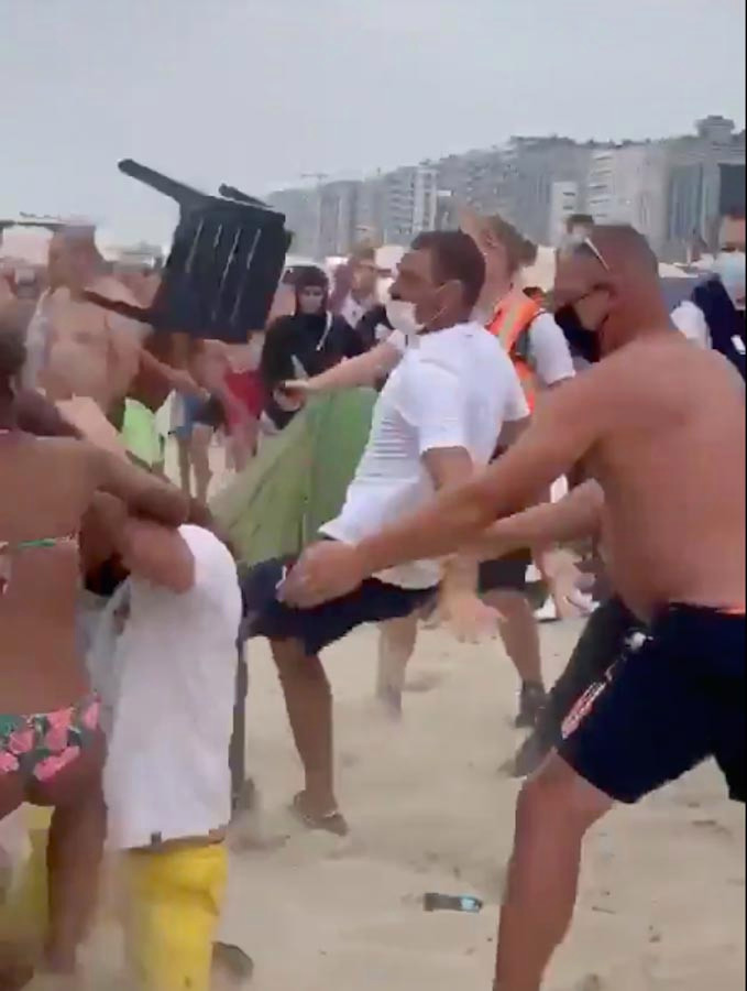 Massive brawl sees beachgoers batter each other with umbrellas and sunbeds in Belgium – The Sun