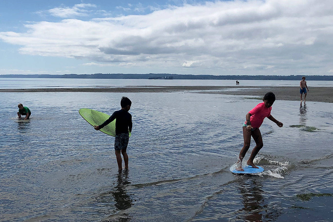 Students skimboard at Double Bluff. Photo by Emily Gilbert/Whidbey News-Times.