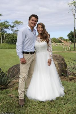 Bindi Irwin standing in the grass: Just married! The young couple were married on March 25, in a makeshift ceremony at Australia Zoo, just before Covid pandemic lockdown