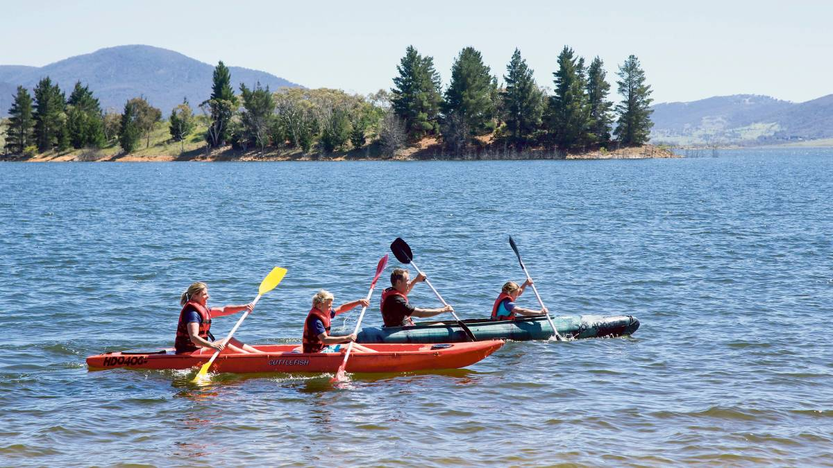 A scenic kayak on Lake Jindabyne in the Snowy Mountains is the perfect family day out. Picture: Destination NSW