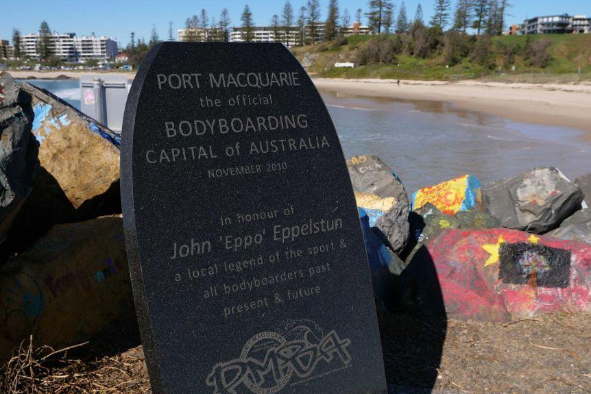 "A plaque in the shape of a bodyboard saying ""Port Macquarie-Bodyboard Capital of Australia:."