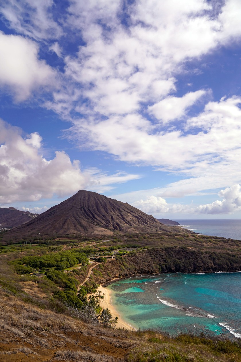 Hanauma Bay with Koko Head in the background from a hiking trail overlooking the popular nature preserve.