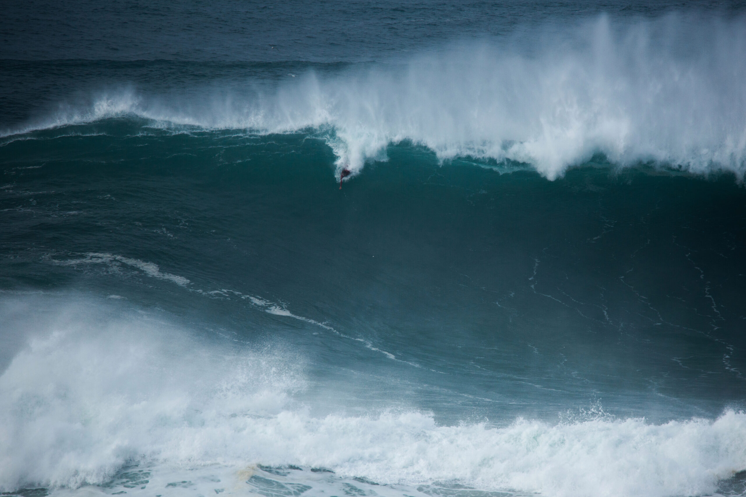 The Man Who Surfs the World's Biggest Waves Without a Board – InsideHook