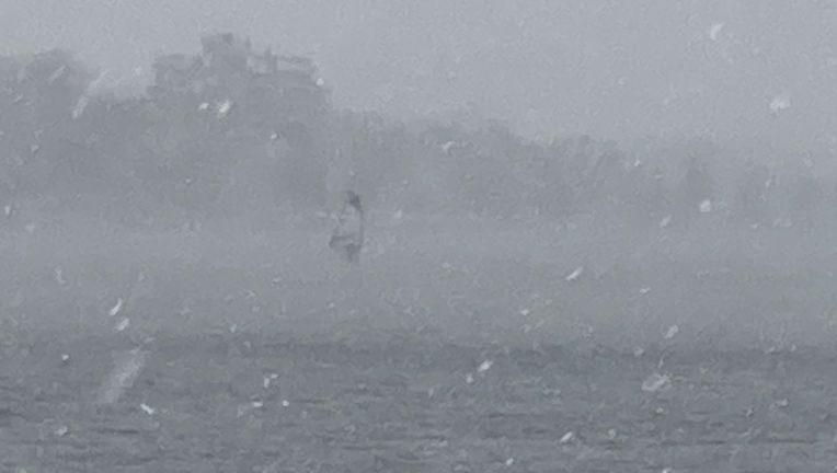 Video: Man seen windsurfing on Minneapolis lake during snowstorm – FOX 9